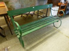 A wrought metal and green painted garden bench A/F