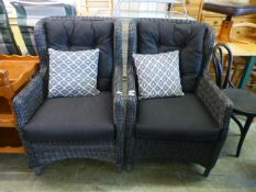 A pair of grey wicker and cushioned garden chairs CONDITION REPORT: Generally good