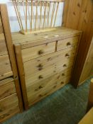 A pine chest of two short over four long drawers