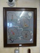 A framed and glazed needlework on a nautical theme