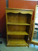 A pine open bookcase