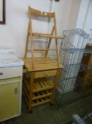 A beech kitchen island along with a beech folding chair
