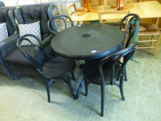 A black PVC garden table along with four matching chairs