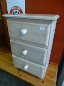 A limed pine bedside chest
