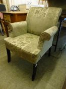 A Parker Knoll armchair upholstered in a floral gold fabric