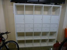 A white laminate storage unit comprising of pigeon holes, drawers and cupboards h. 182 cm, w.