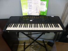 A Technics KN750 keyboard with stand and music
