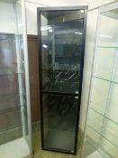 A black framed display cabinet with two doors. h.