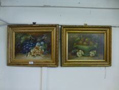 A pair of gilt framed oil on boards of still life signed bottom right