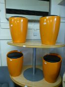 A set of four orange and black leather effect pad seated stools