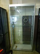 A metal framed display cabinet with four adjustable shelves and lockable doors, h.