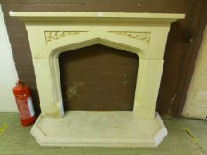 A modern painted plaster fire surround