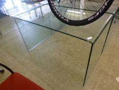 A curved glass table/desk