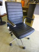 A black leather effect office chair on five star base