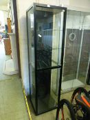 A black framed and glazed display cabinet, h.