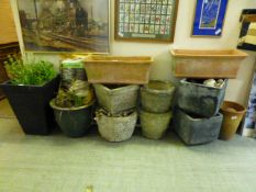 A selection of garden pots, to include terracotta,