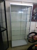 A metal framed display cabinet with five adjustable shelves and two side doors, h.