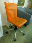 An orange leather effect office chair on five star chrome base