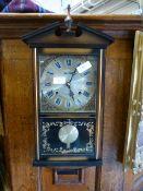 A modern drop dial wall clock