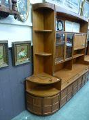 A full height mid-20th century design teak corner cabinet having open torage above a pair of doors