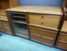 A mid-20th century design cabinet having a glazed door with drawer and cupboard by Nathan
