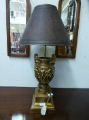 A reproduction gilt lamp with figure design