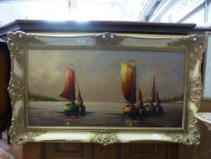 A gilt framed oil on canvas of sailing boats signed T.