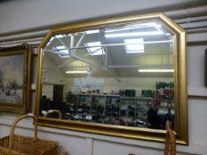 A modern gilt framed bevel glass wall mirror