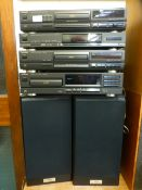 A Technic stacking system comprising of three compact disk players,
