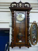 A late Victorian walnut Vienna wall clock