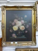 An ornate gilt framed oil on canvas of still life