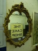 An ornate gilt framed wall mirror
