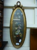 An ornate gilt oval framed and glazed oil of still life signed at bottom