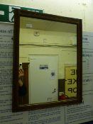 An early 20th century walnut framed wall mirror