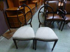 A pair of early 20th century mahogany balloon back hall chairs