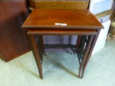 A nest of two early 20th-century mahogany occasional tables