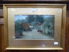 A gilt framed and glazed water colour of cattle in village scene signed bottom right A H 1909