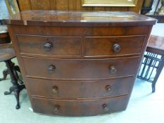 An 19th century flame mahogany bow fronted chest of two short over three long drawers