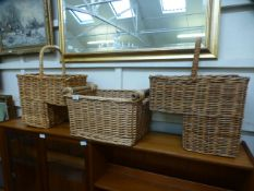 A pair of wicker stair baskets together with one other
