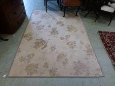 A modern Laura Ashley rectangular rug with rose design