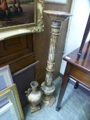 A marble columned jardiniere stand together with a similar twin handled urn