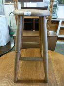 A turned oak penny seated stool