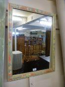 A floral framed mirror