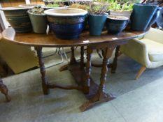 An early 20th century oak gate leg table