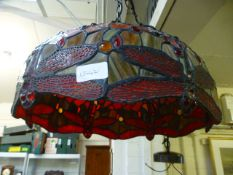 A Tiffany style leaded light lamp shade with dragonfly design