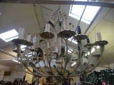 A multi branch metal leaf design chandelier
