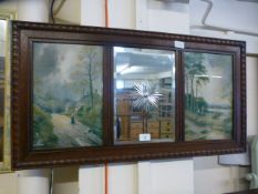An early 20th century etched mirror flanked by prints of country scenes