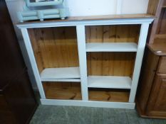 A pine and painted adjustable bookcase