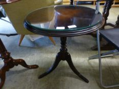 A reproduction circular topped occasional table