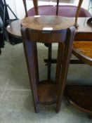 An early 20th century oak jardiniere stand